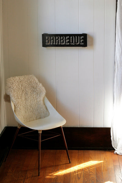 "18 "" metal sign that stands one inch off the wall and reads, ""BARBEQUE"""