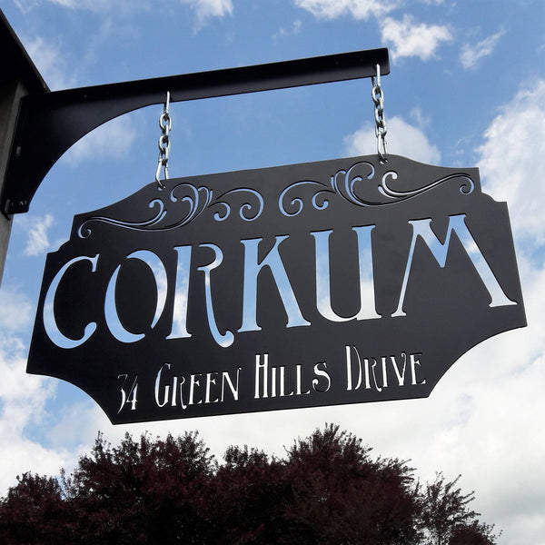 "This custom metal sign is Powdercoated and comes with a matching hanging post, silver chain and carabiners. The hanging sign reads, ""Corkum in Green Hills Drive"". it is an address sign"