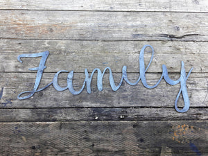 "Rustic metal sign in the shape of a cursive word which reads, ""Family""."