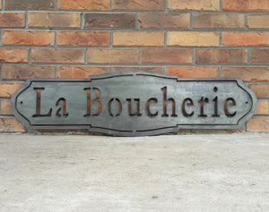 "French country, raw steel, metal sign which reads, ""La Boucherie"""