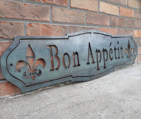 "French country, raw steel, metal sign which reads, ""Bon Apetit"""