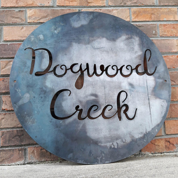 "Round Personalized sign that reads, ""Dogwood Creek""."