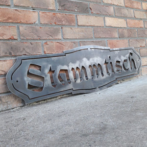 "This Metal Sign is written in German and reads, "" Stammtisch"""