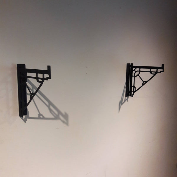 These metal shelf brackets are a contemporary design and fit standard lumber sizes