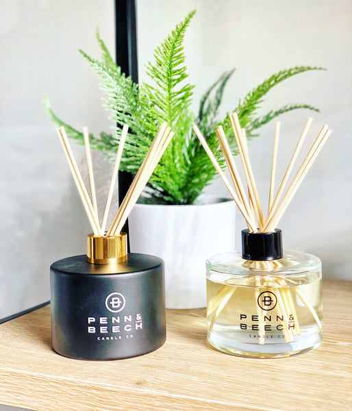 Black and Clear reed diffuser with fern