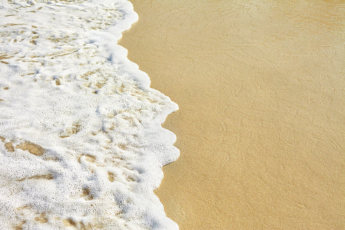 Ocean wave on the sand