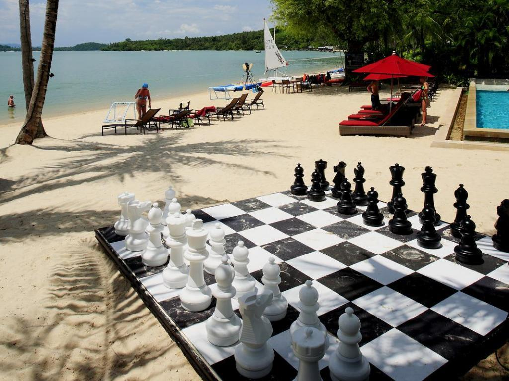The Village Coconut Island Beach Resort Sports a MegaChess Plastic Giant Chess Set with a 25 Inch King