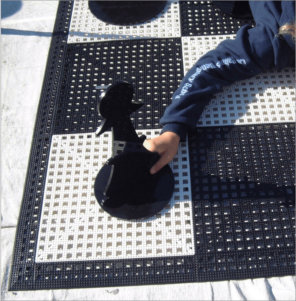 MegaChess Commercial Grade Roll Up Giant Chess Board with 12 Inch Squares 8' x 8' Available ADA Compliant Safety Edge Ramps | No Edge Ramps | MegaChess.com