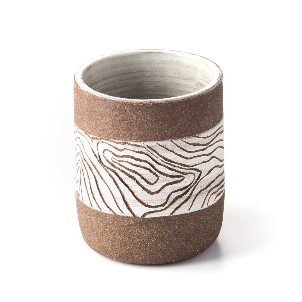 Uzumati Ceramics Topo Tumbler Inspired by the never ending pursuit of adventure in wild places these hand-carved topographic tumblers are sure to summon the wanderlust inside.