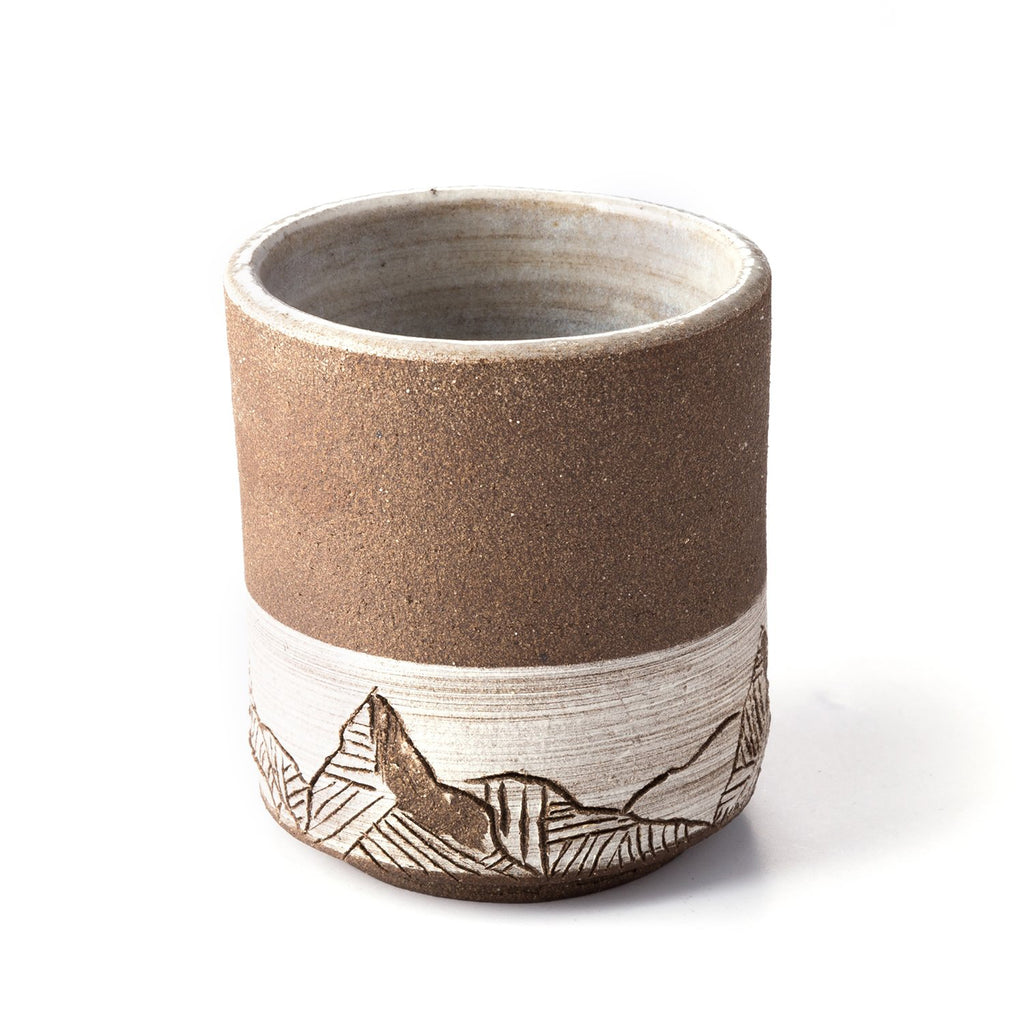 Uzumati Mountainscape Mug A rustic, mountain-inspired mug hand-thrown and carved into durable stoneware ready to keep up with your adventurous spirit.