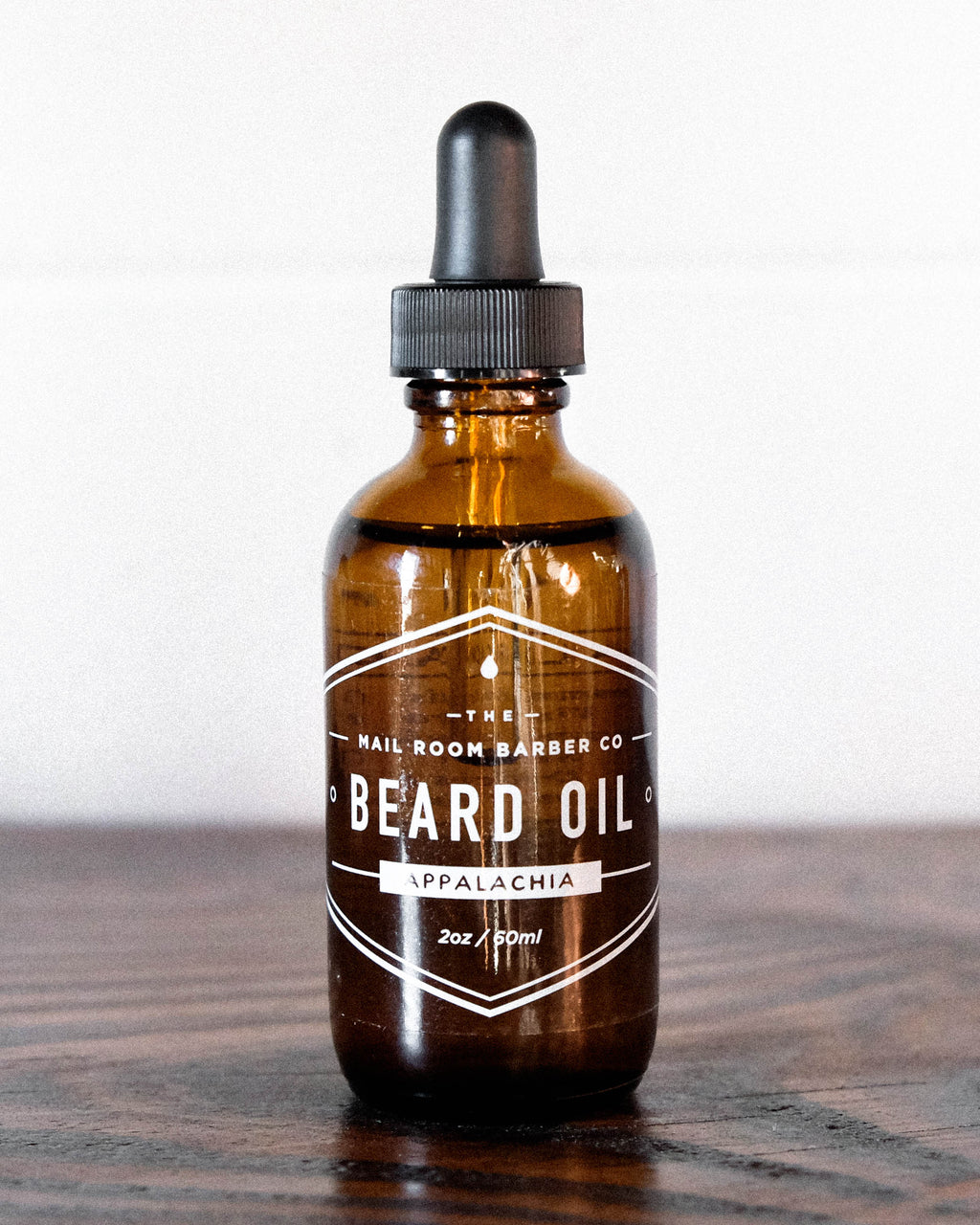Beard oil designed to soften and nourish your beard made by Florence, SC sustainable brand and makers Mailroom Barber. Available in scents: Appalachia, Tea Tree, and Pipe Tobacco. Grooming products that are made using 100% ethically sourced ingredients and packaging.