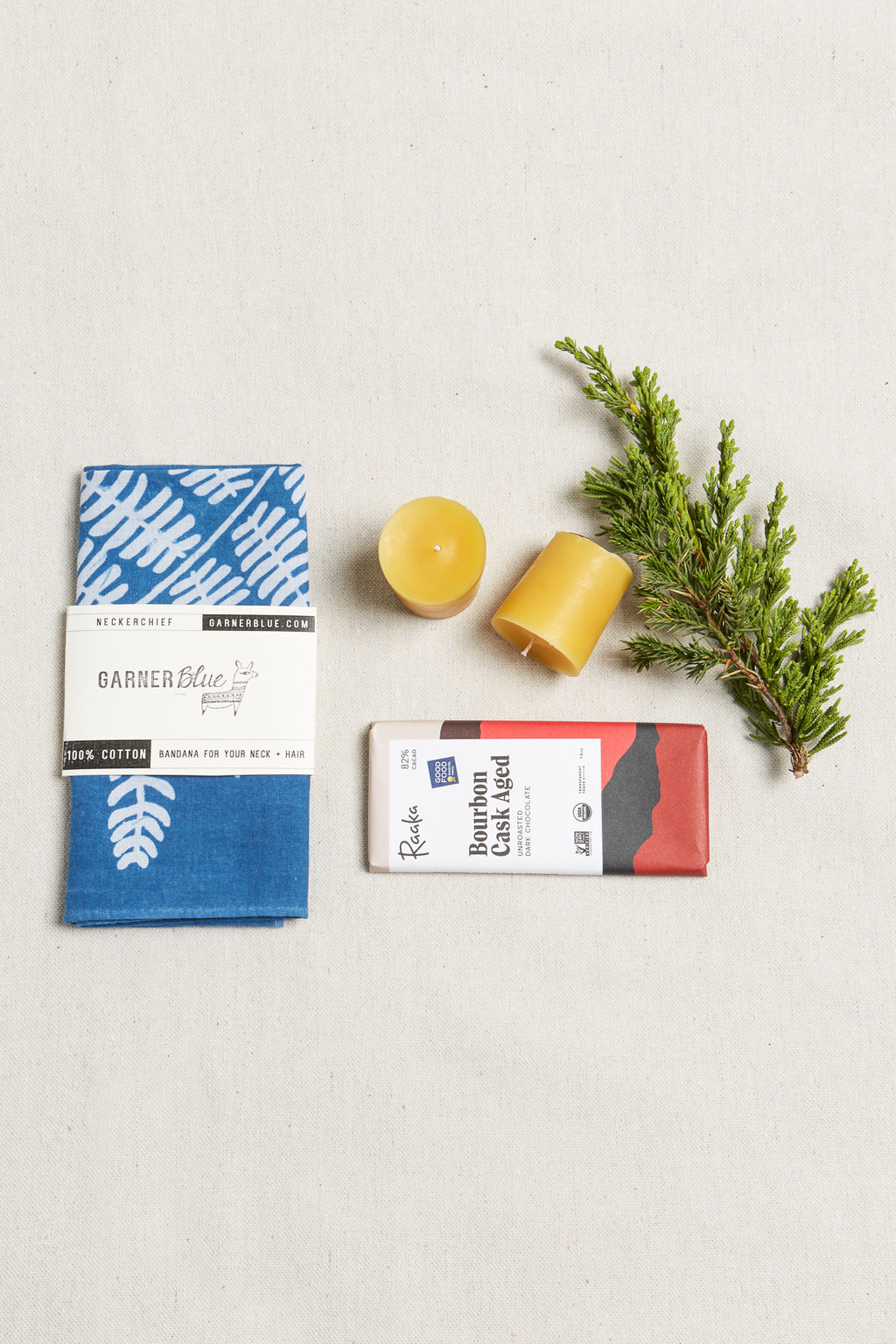 A plant & bee lovers dream! We've paired Garner Blue's natural indigo bandana with our Holiday Beeswax Votive Duo and Raaka Artisan Organic Chocolate. A bandana that not only shows it's love of plants, but also uses plant-based dye. 100% Cotton | 100% Beeswax. Handmade in Nashville by Cotton and Moss.