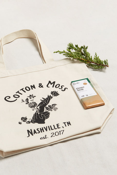 Cotton and Moss Farmhand Bag and Chocolate Gift Set. Calling all farmers market fans! Our Garden Essentials Tote features a hand illustration representing the many hands that go into growing food, fiber, and flowers. In honor of our farmers & gardeners! Made with 100% organic 10 oz cotton canvas and durable cotton webbing.