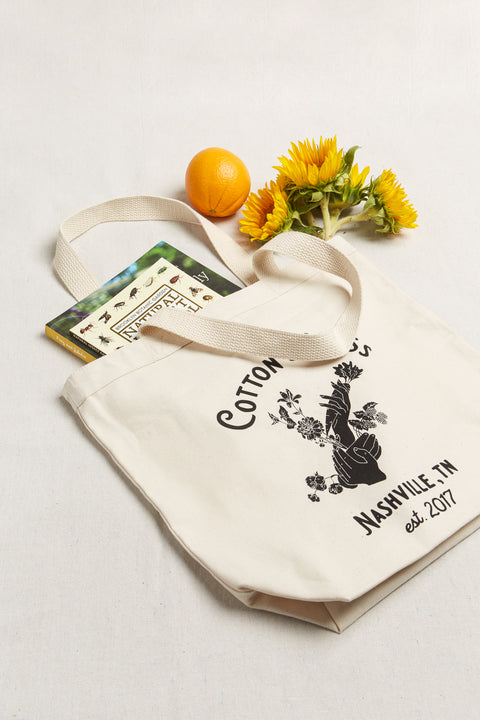 Introducing the Cotton & Moss Garden Essentials Tote that features a hand illustration representing the many hands that go into growing food, fiber, and flowers. In honor of our farmers & gardeners! Made with 100% organic 10 oz cotton canvas and durable cotton webbing.
