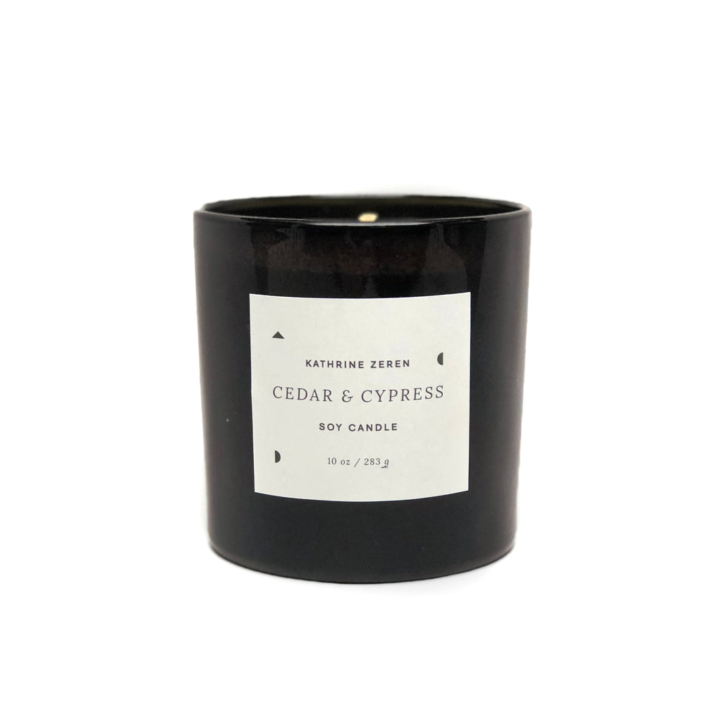 All-natural candles made by O'Douds for Texas maker, Kathrine Zeren. American-grown soy wax and therapeutic-grade essential oils with scent notes of Cedar, Cypress, Amber, and Orange. Burn time of 45+ hours.