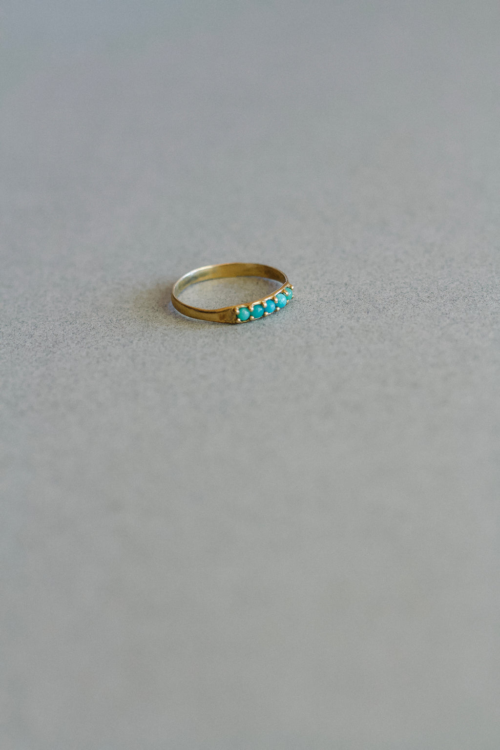Five 2-millimeter turquoise stones are set in this simple and delicate lost wax cast ring made by Mimosa Handcrafted.  The perfect gift for the bold or minimalist in style! Handmade in south Louisiana. Makers Workshop