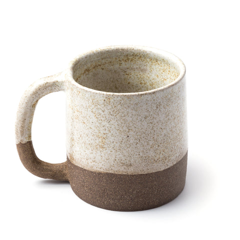 Uzumati Ceramics mug half-dipped in a speckled glaze mimicking a light dusting of snow in the Sierra. The Snow Creek Mug nestles into your hand with comfort and ease — perfect for coffee while catching the first light of day or campfire coco after a long day of adventure.