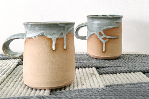 "Dirty Pour Series.  Inspired by Bahamian mornings spent paddling to town for a morning coffee. Glazed using a ""dirty pour"" glazing technique leaving no two mugs the same! Raw clay at the sides add a nice texture to your morning pick-me-up. We recommend hand washing these mugs for longevity."