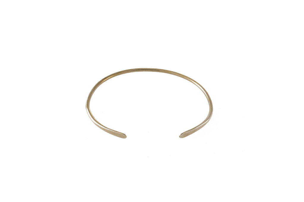 "Ellen Mote Tola Cuff Solid brass cuff with hammered ends, measuring 2.5"" x 2"""