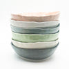 stack of small bowls by Nona Kelhofer