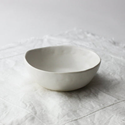 white breakfast bowl on white linen