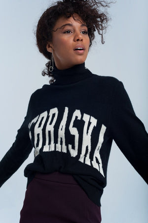 Black turtleneck sweater printed text