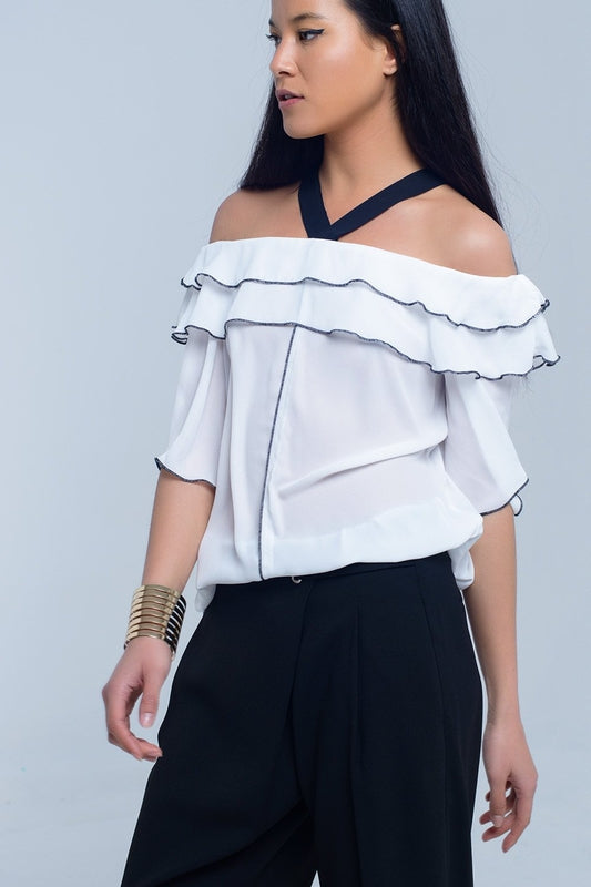 White top with black contrast trim