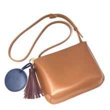 Lana sling bag with tassel and round compact mirror