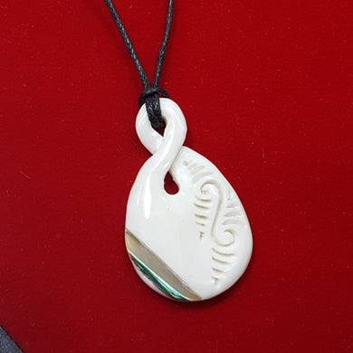 Bone and Paua Twist Carved Pendant