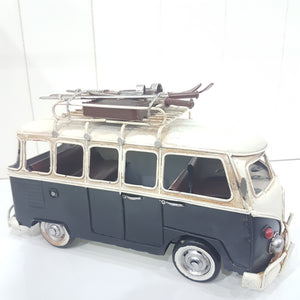 Black VW Combi with Skis