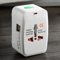 Universal Power Adapter with USB - Plugs into the most common sockets in the Universe - InterSurfing