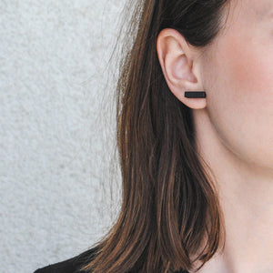 The earrings are handmade from local wood, features sterling silver studs.