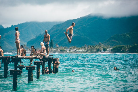 tropical island pier jumping