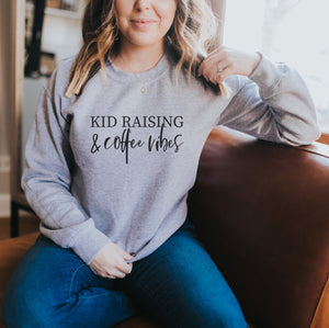 Kid Raising & Coffee Vibes - Sport Grey Unisex Fleece Pullover