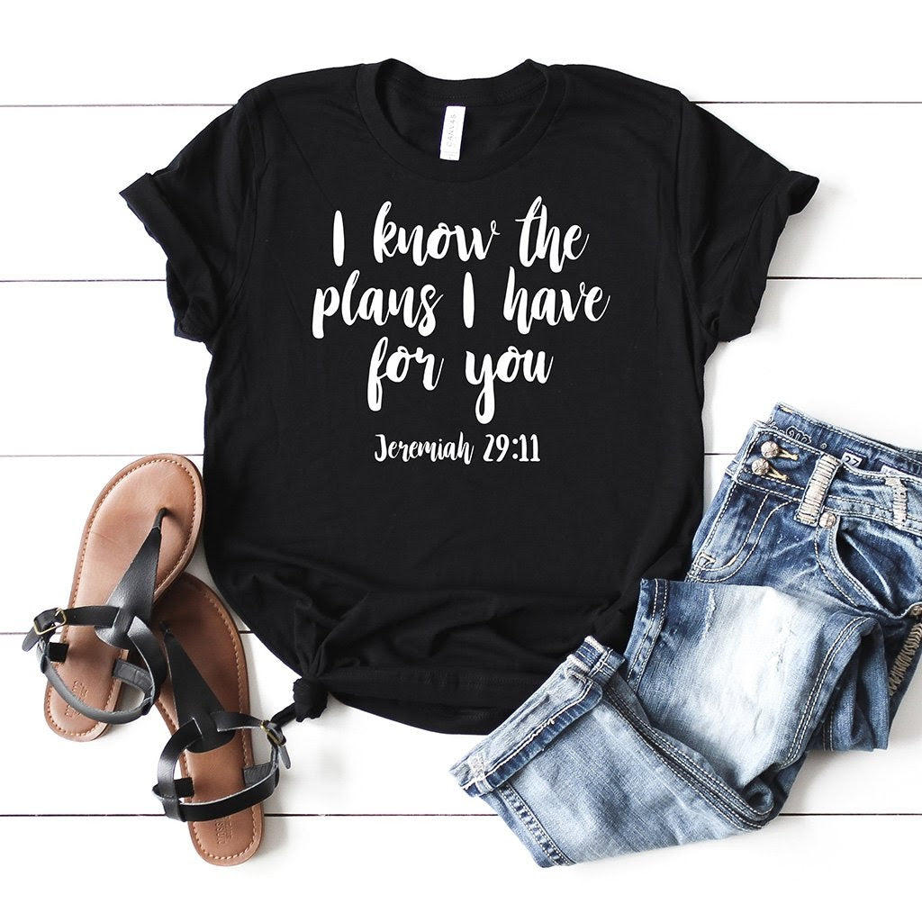 Black crewneck shirt with a bible verse from Jeremiah.