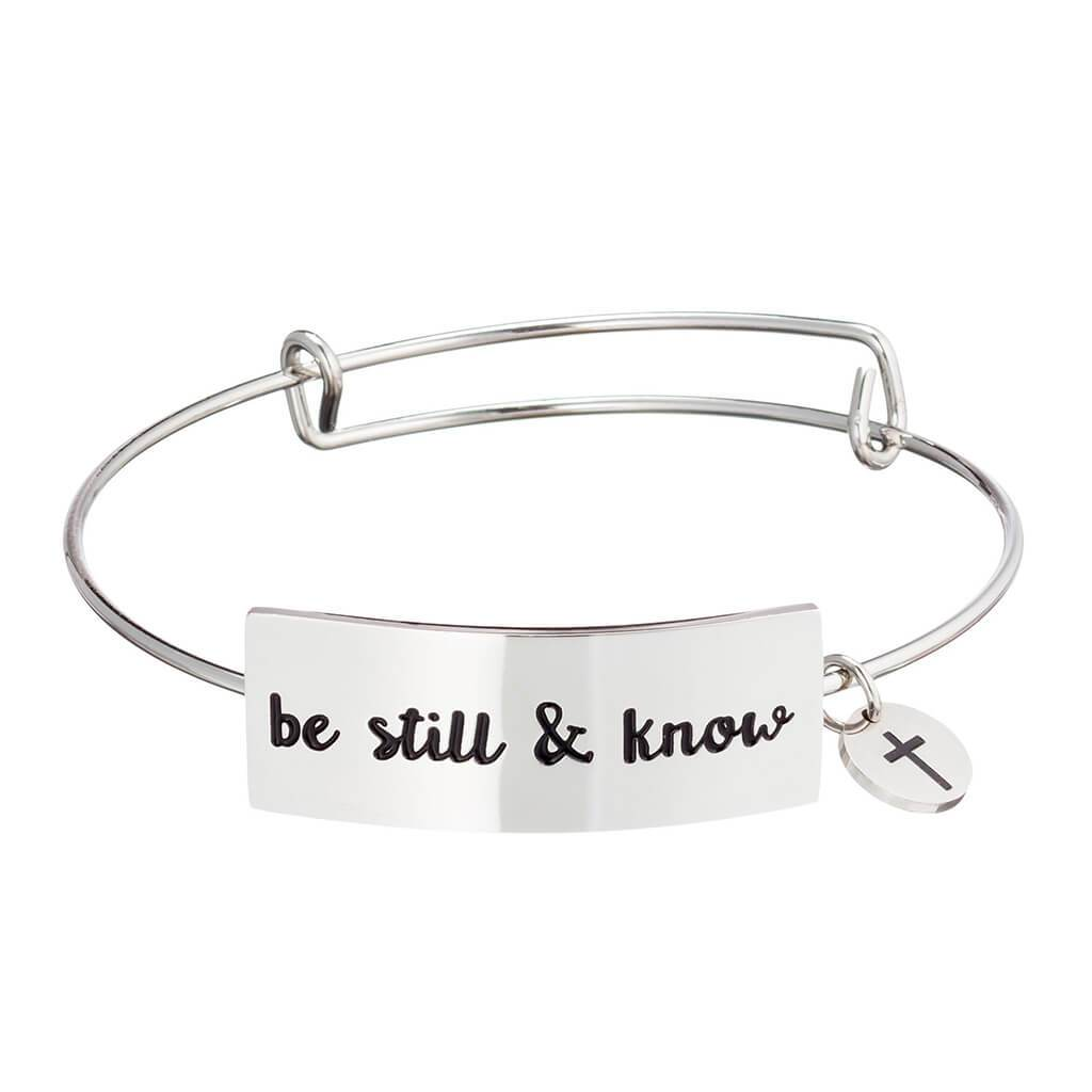Stainless steel Christian bangle bracelet on white background