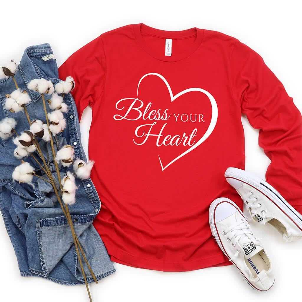 Red long sleeve shirt with a heart and text that reads bless your heart