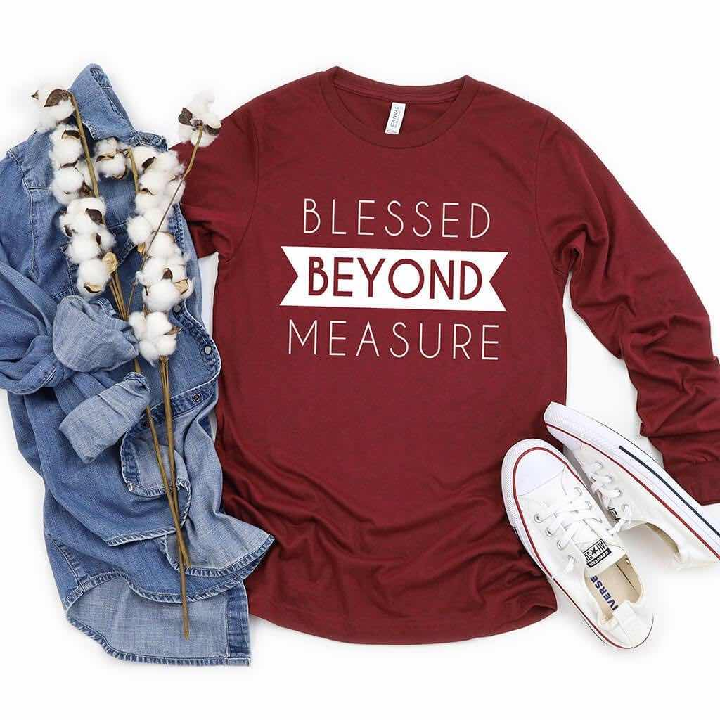 Long sleeve shirt that reads blessed beyond measure