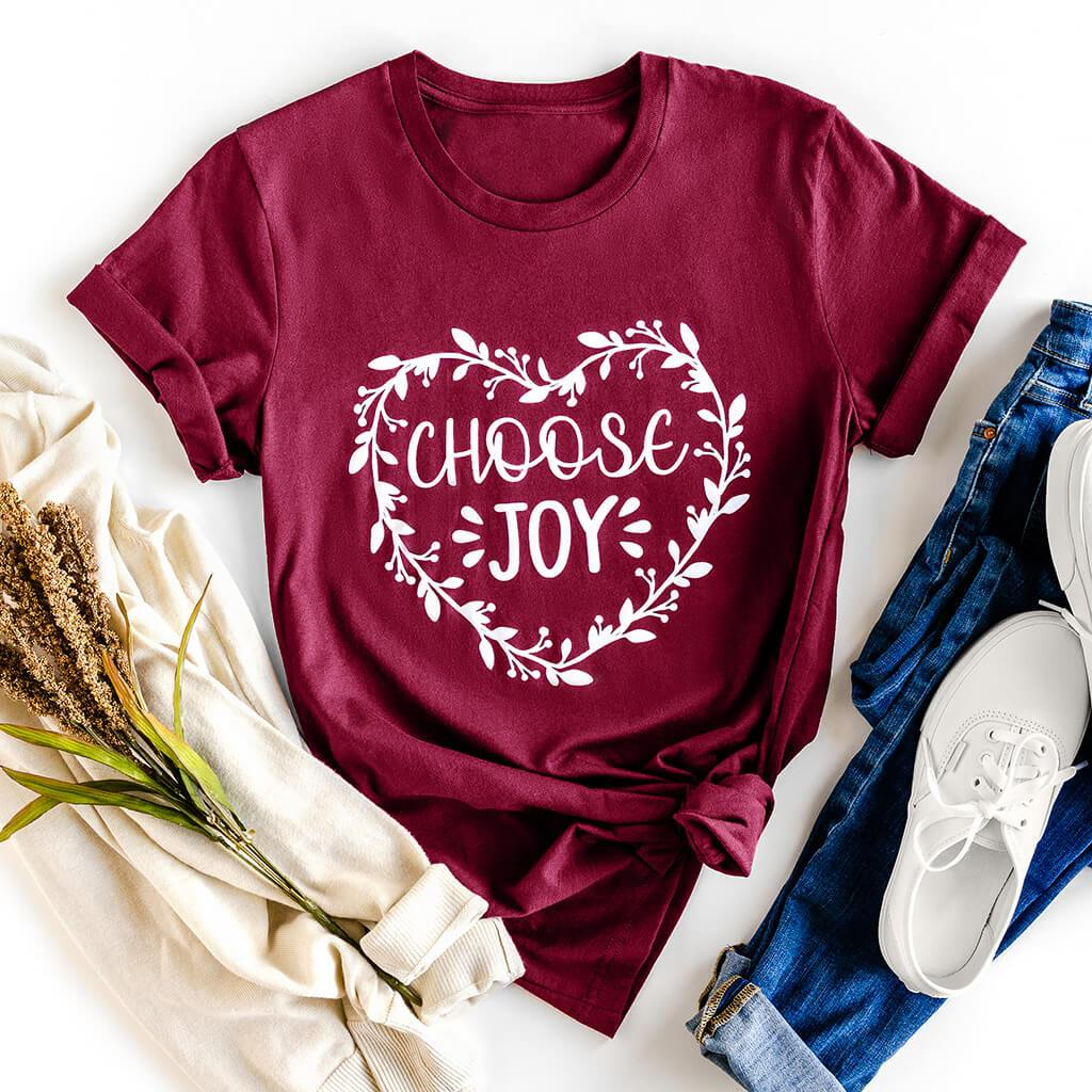 "Maroon tee shirt with heart made of flowers and a ""choose joy"" inscription"