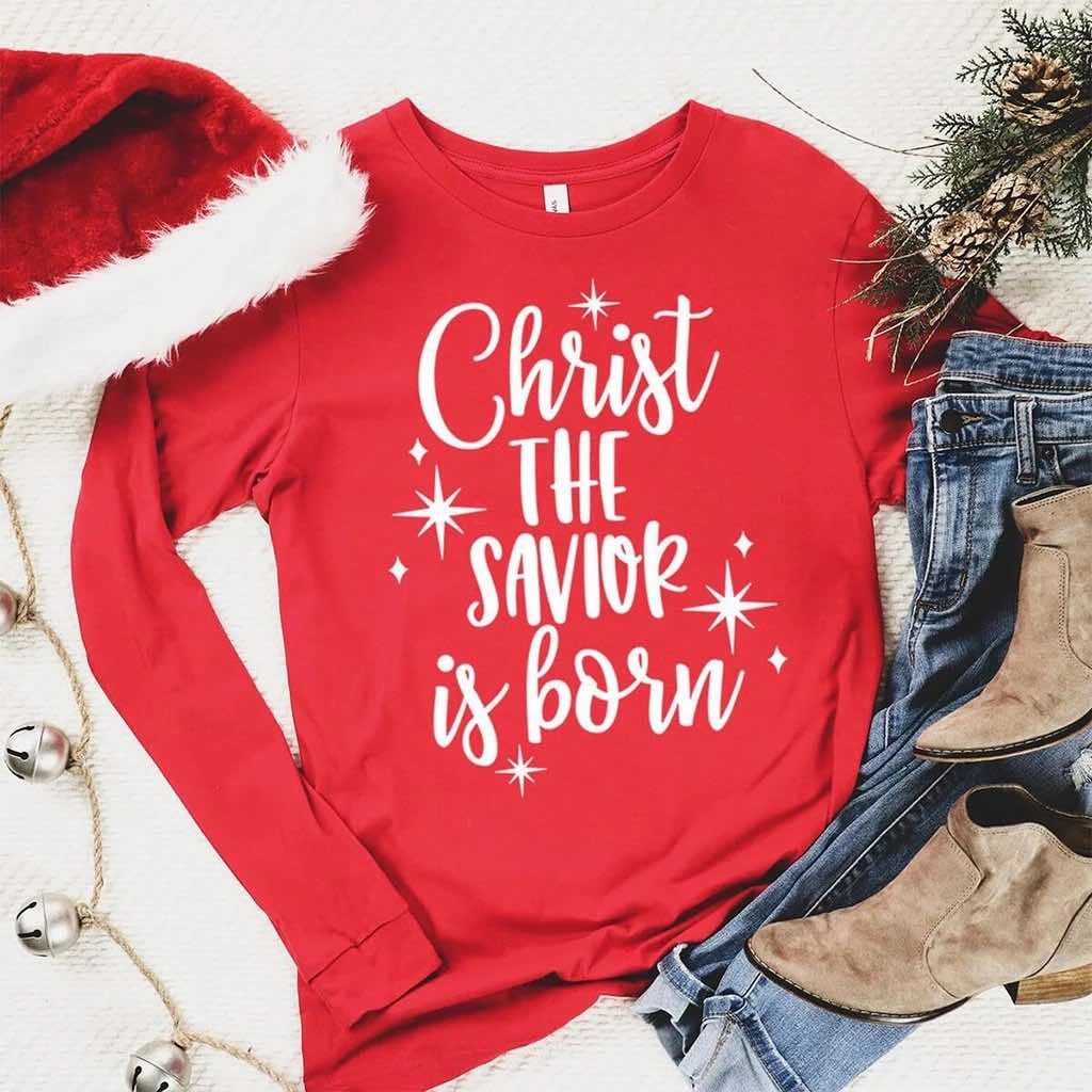 "Christmas long sleeve shirt with sparkling stars and elegant ""Christ the savior is born"" design"