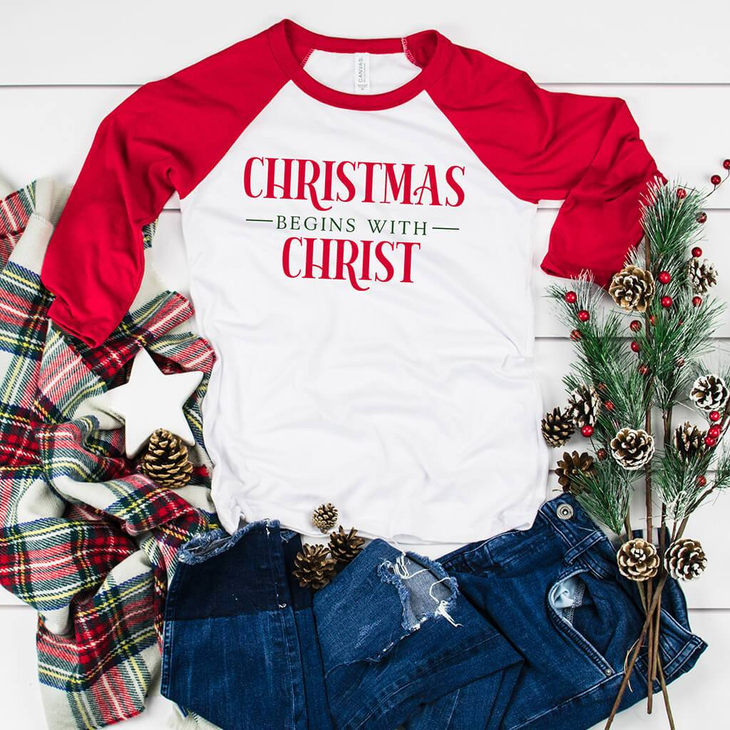 Red 3/4 sleeve raglan shirt with red and green Christmas graphic design