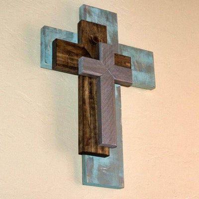 Decorative three part cross hanging on wall