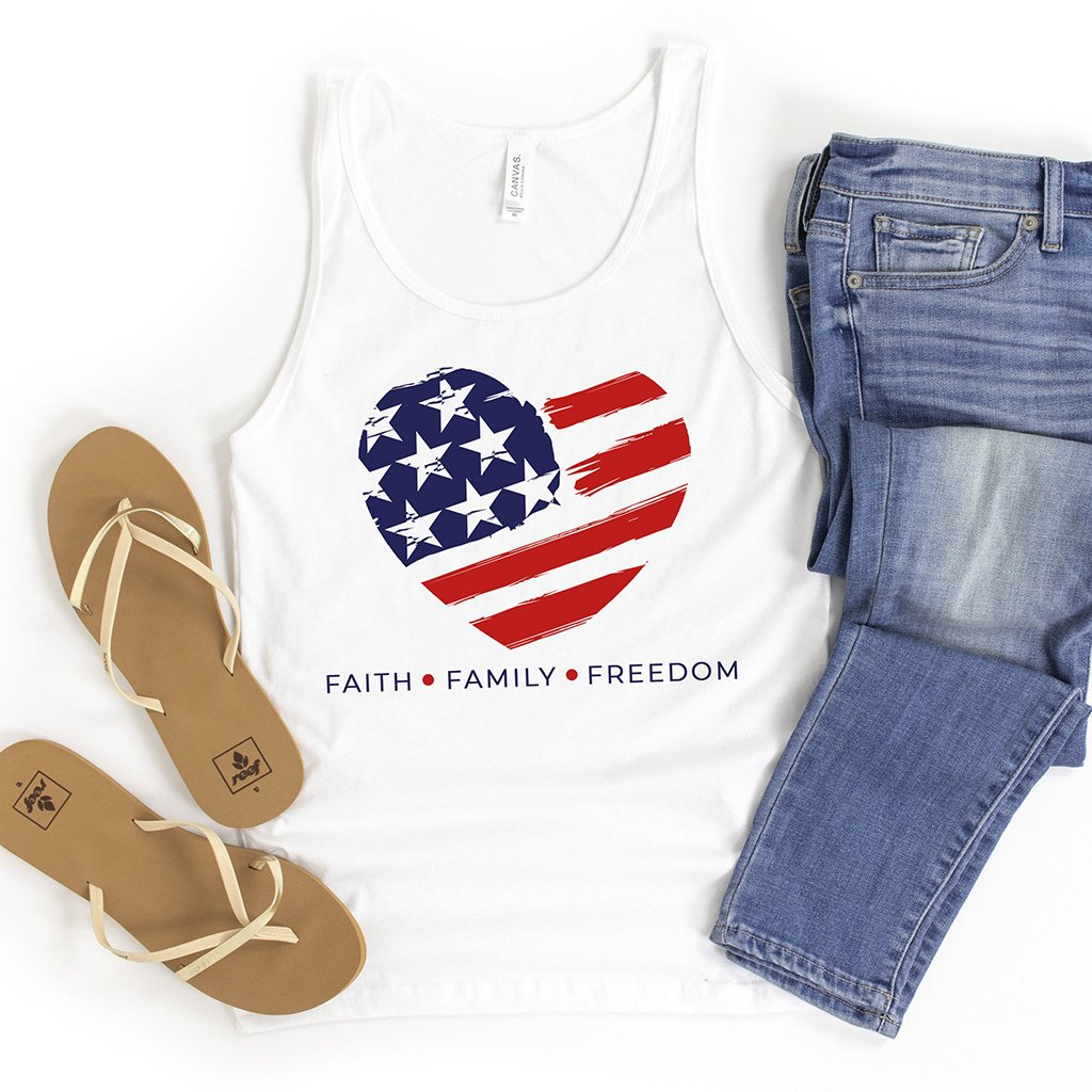 An American flag design inside of a heart shape printed on a white tank top