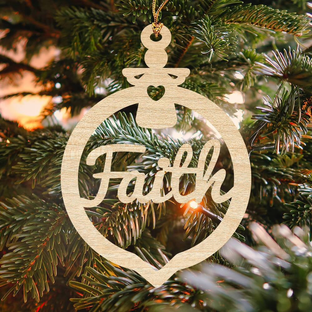 "Laser cut wooden Christmas ornament that reads ""Faith"" inside of a bulb design"