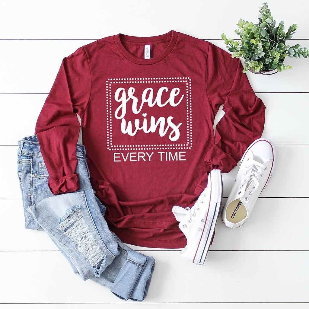 "Cozy long sleeve Christian shirt with a box design and text reading ""grace wins every time"""