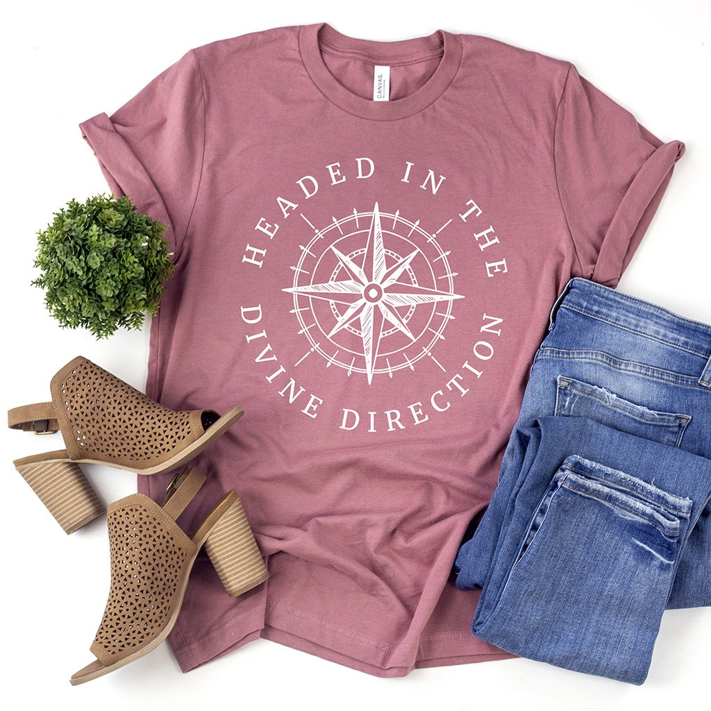 "Compass graphic design on a cute mauve t-shirt that reads ""headed in the divine direction"""