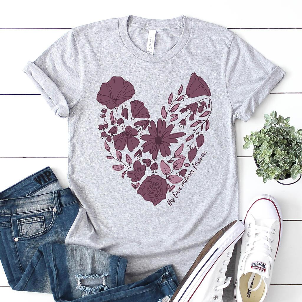 "Floral Christian t-shirt that reads ""His love endures forever"" inspired by Psalm 136."