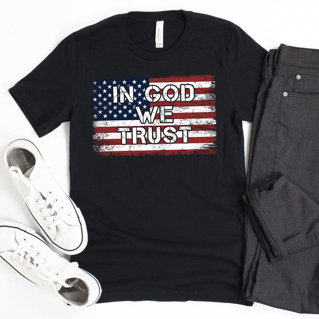 "Men's Christian shirt that boldly states ""In God We Trust"" superimposed on a full color American flag"