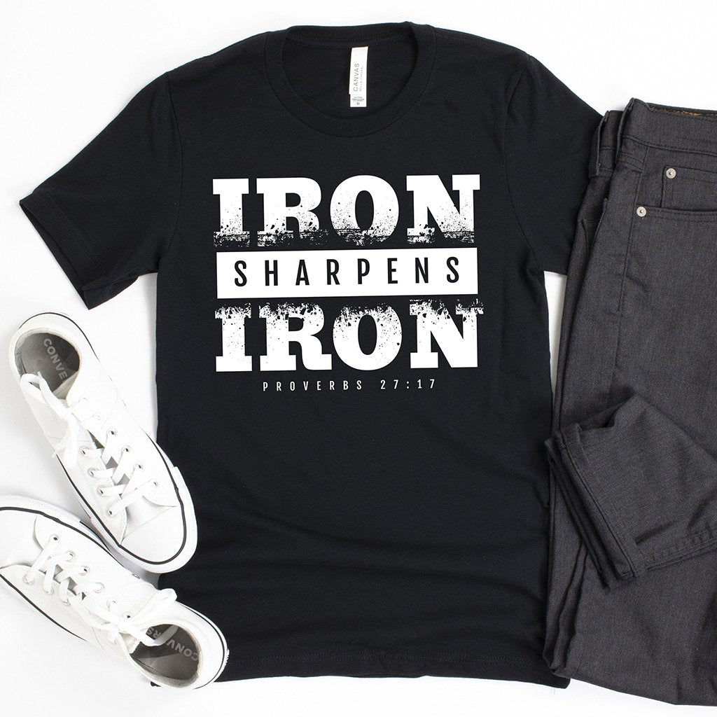 "Bold statement shirt for men in black that states ""iron sharpens iron"" from Proverbs 27:17"