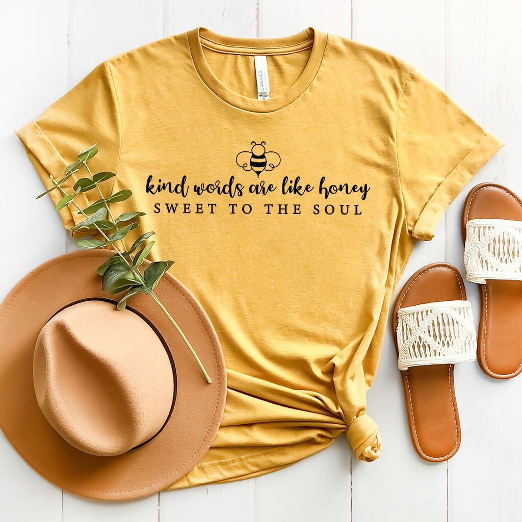 Simple mustard t-shirt featuring a bumblebee and Bible verse